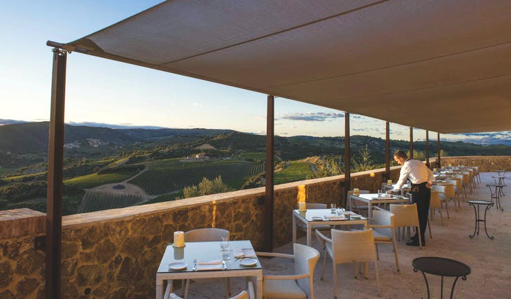 Castello di Velona Tuscany restaurant terrace outdoor dining overlooking countryside