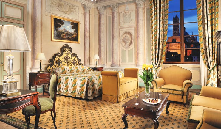 Grand Hotel Continental Tuscany noble junior suite bed living area ornate décor
