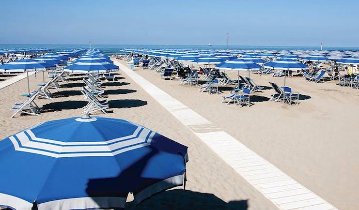 Principe di Piemonte Tuscany beach sun loungers umbrellas