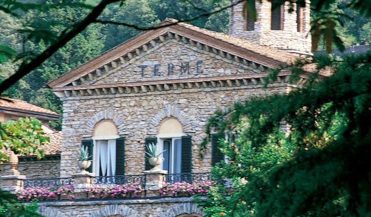 Grotta Giusti Tuscany entrance exterior hotel building balcony flowers