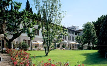 Grotta Giusti Tuscany gardens lawns trees flowers hotel building