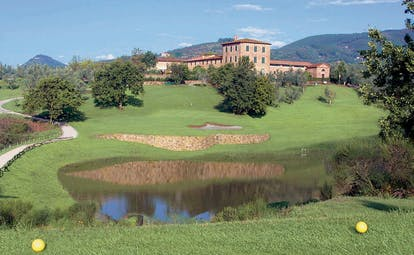 Grotta Giusti Tuscany golf course pond green hotel building in background