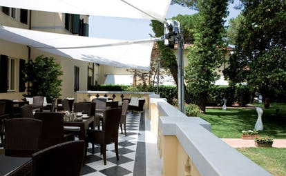 Hotel Byron Tuscany dining terrace outdoor dining patio overlooking gardens