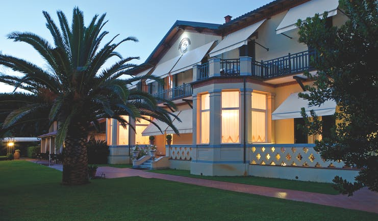 Hotel Byron Tuscany hotel exterior at night lawns trees hotel building