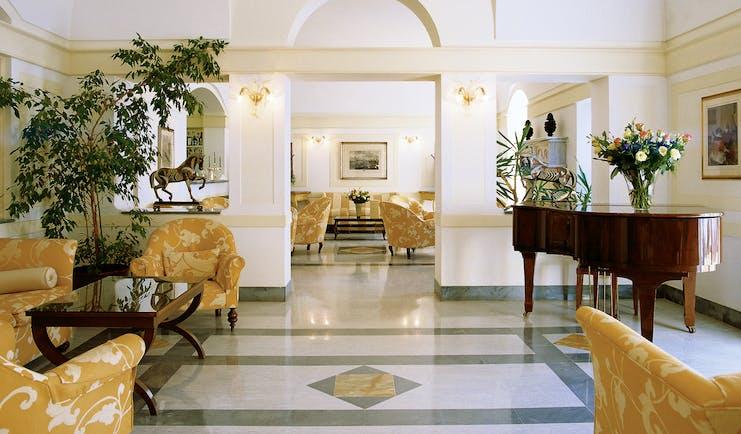 Hotel Byron Tuscany lobby sofas armchairs elegant bright décor