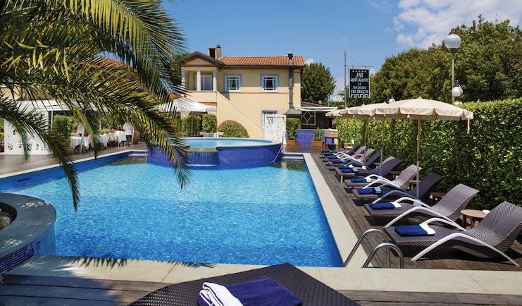 Hotel Byron Tuscany pool sun loungers umbrellas