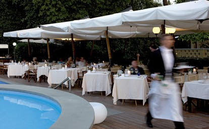 Hotel Byron Tuscany poolside dining outdoor dining overlooking pool