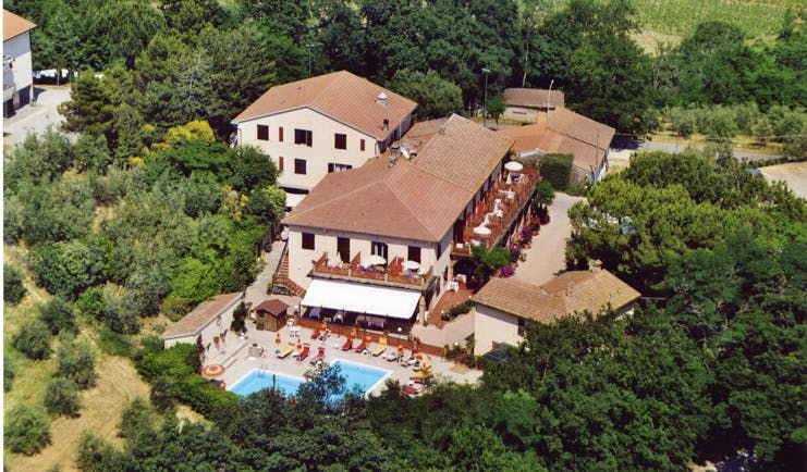 Hotel Le Renaie Tuscany aerial shot of hotel buildings pool surrounding countryside