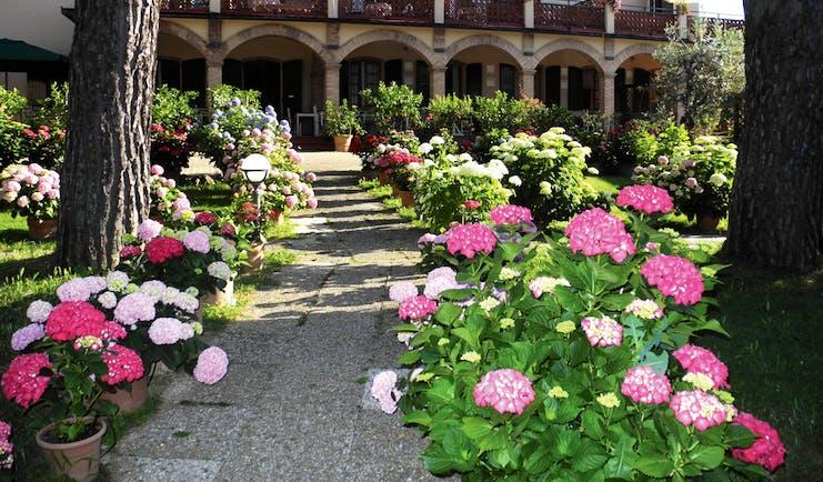 Hotel La Renaie Tuscany exterior pathway flowers