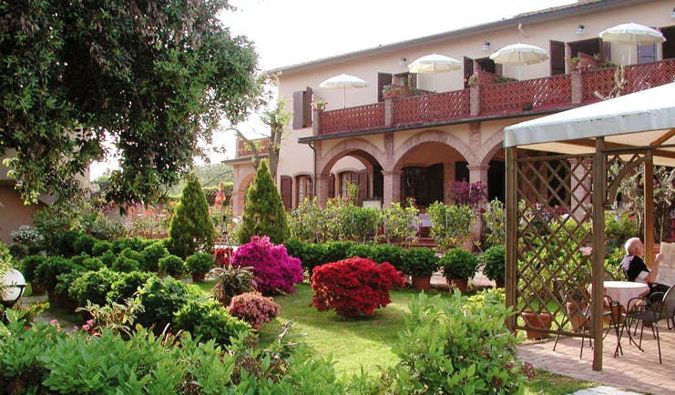 Hotel Le Renaie Tuscany hotel grounds gardens hotel building patio lawns trees flowers