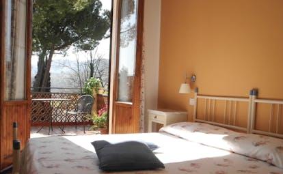 Hotel La Renaie Tuscany superior room traditional décor doors leading to balcony