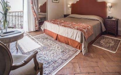 Palazzo Leopoldo Tuscany superior room bed cosy décor