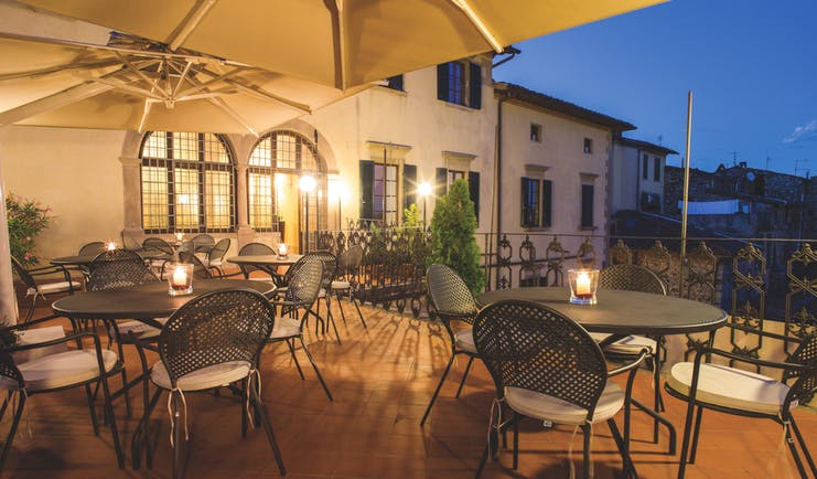 Palazzo Leopoldo Tuscany terrace outdoor seating area at night