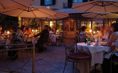 Relais dell'Orologio Pisa patio dining outdoor dining at night tables umbrellas