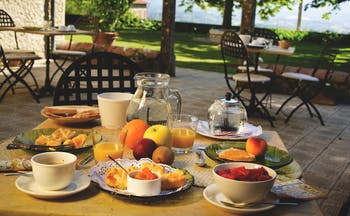 Relais Villa Belpoggio Tuscany dining terrace outdoor breakfast table fruit toast