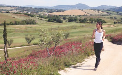 Terme di Saturnia Tuscany female jogging through the Tuscan countryside
