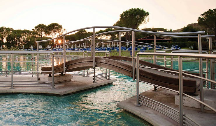 Terme di Saturnia Tuscany pool bridge over water