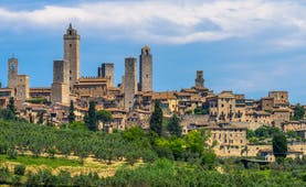Outline against sky of the towers and houses of the Tuscan town of San Gimignano