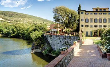 Villa La Massa Tuscany front view of hotel bridge over Arno river
