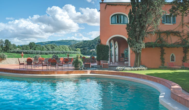Villa La Massa Tuscany pool outdoor seating countryside in background