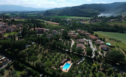 Aerial view of hotel with pool and olive groves