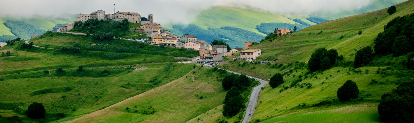 Green rolling hills of Umbria with hilltop village
