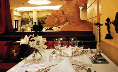 Restaurant with statue and dining table set up for dining