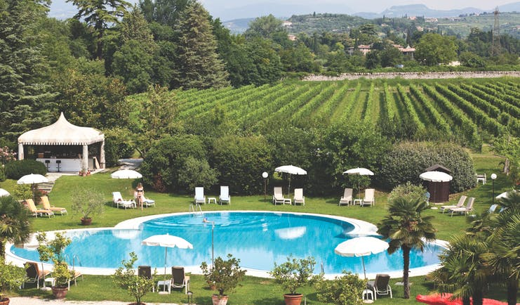 Villa Del Quar Veneto poolside lawns sun loungers view of vineyards