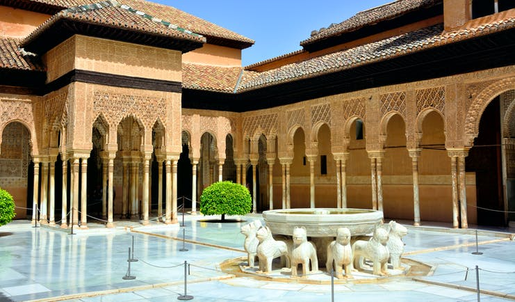 Fountain and arches of the Moorish Court of Lions at the Alhambra in Granada