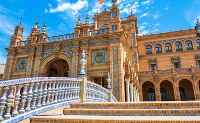 The orange brick and blue and white ceramics decorating the Plaza de Espana in Seville
