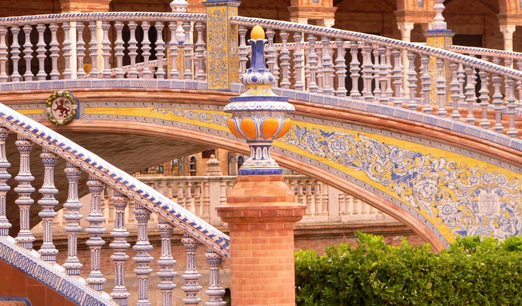 Ornate staircase with arches of building at the Plaza de Espana in Seville
