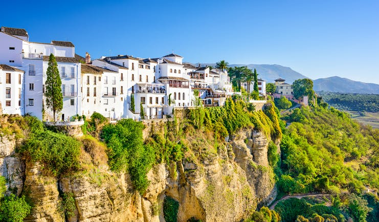 White washed houses in Ronda perched on the edge of the cliff
