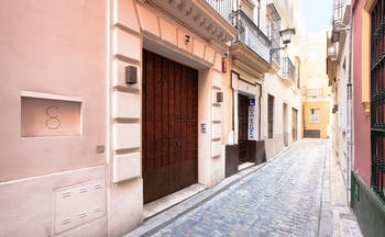 Corral del Rey Seville entrance side street wooden doors