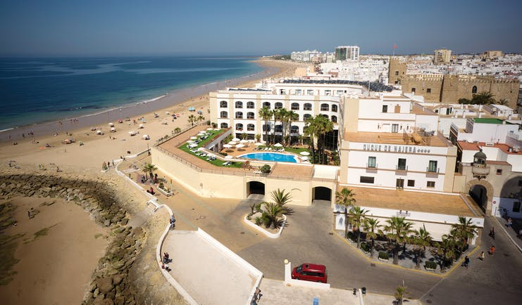 Duque de Najera Andalucia aerial shot hotel pool beach town in background