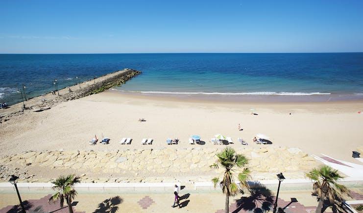 Duque de Najera Andalucia beach sandy beach sunbathers
