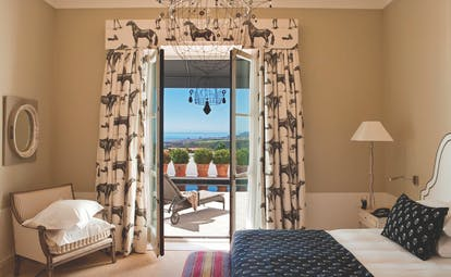 Finca Cortesin Andalucia pool suite bed chair modern décor terrace overlooking pool