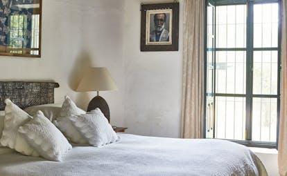 Hacienda de San Rafael Andalucia bedroom bed large window cosy decor