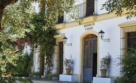 Hacienda de San Rafael Andalucia exterior white building hotel entrance greenery