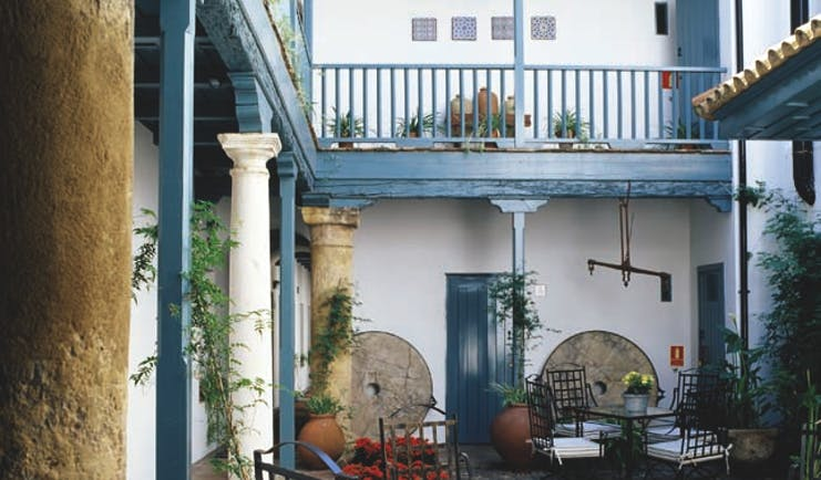 Las Casas del Rey Seville courtyard outdoor seating area tables chairs