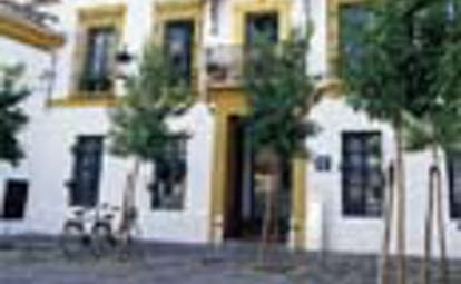 Las Casas del Rey Seville exterior white building yellow features trees