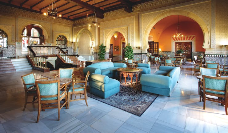 Hotel Alhambra Palace lobby with green and wooden seats