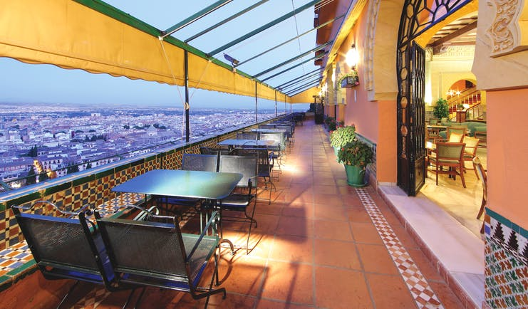 Terrace with black seating looking over Andalusia