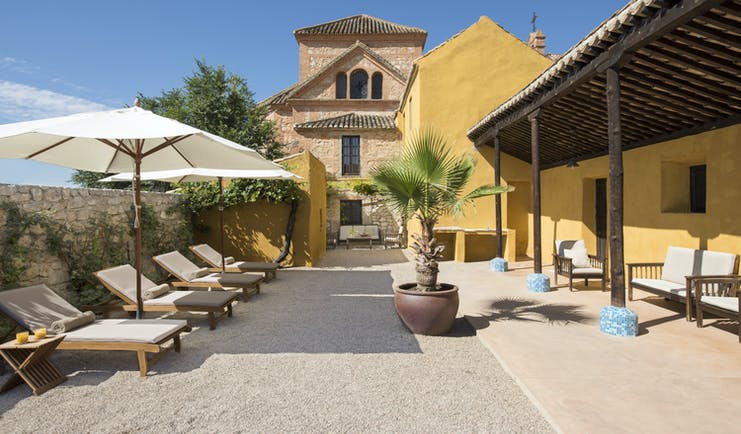 Cortijo de Marques Andalucia courtyard outdoor seating sun loungers