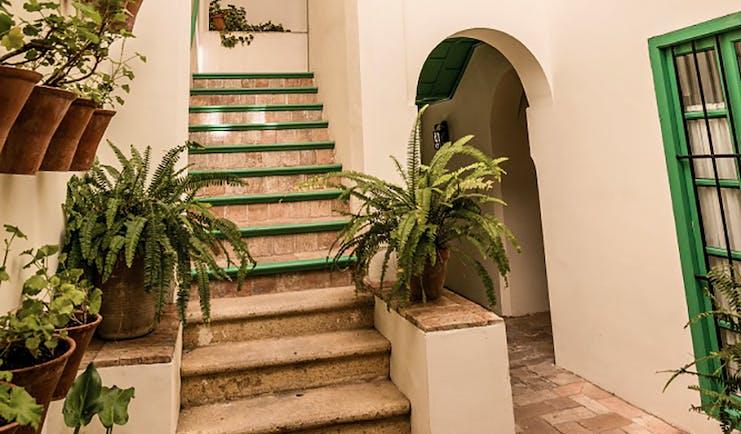 Las Casas de la Juderia Andalucia stairs stone steps plant pots