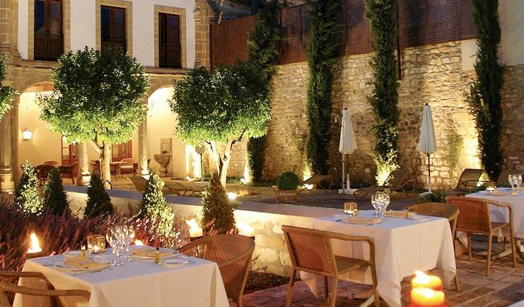 Hotel Puerta de la Luna Andalucia outdoor dining at night terrace trees candle lights