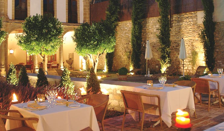 Hotel Puerta de la Luna Andalucia outdoor dining at night terrace trees candle lights