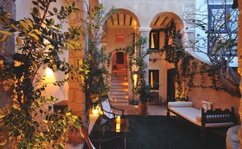 Hotel V Andalucia courtyard outside seating area trees vines stone walls
