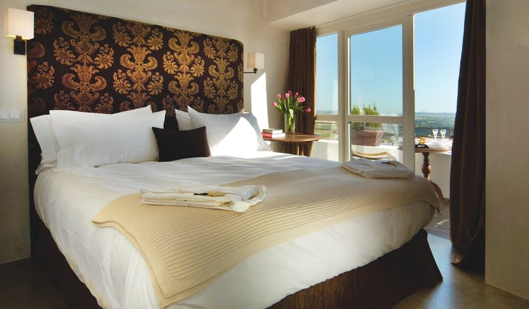 Hotel V Andalucia guest room large bed doors leading to balcony modern décor