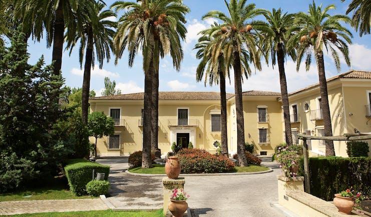 Villa Jerez Andalucia exterior hotel building driveway palm trees