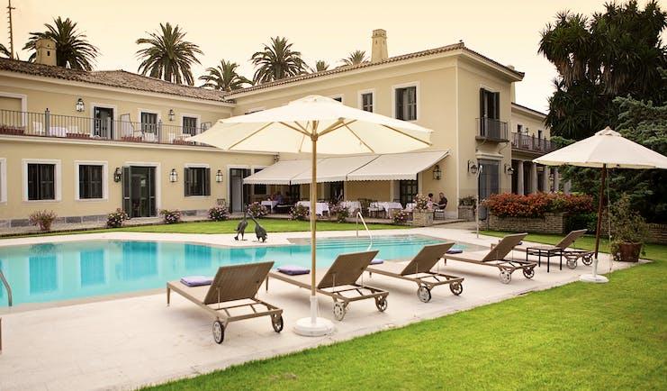 Villa Jerez Andalucia pool sun loungers umbrellas lawn